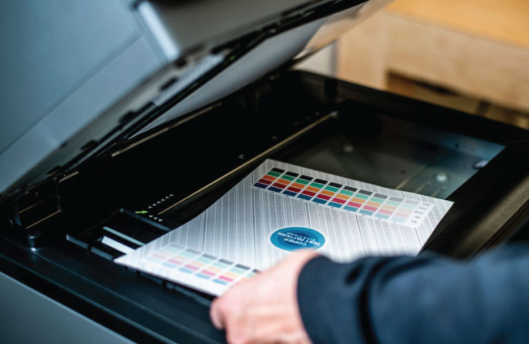 Person Copying a Colour Document on a Photocopier